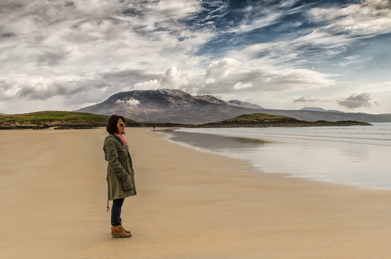 Woman on a beach by John Mee Photography